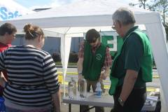 Volunteer Bryon Powell demonstrates how to purify water