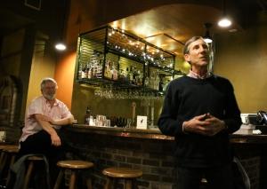 Doug Starcher looks on